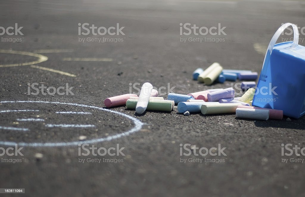 Container of Sidewalk Chalk Dumped out on Ground royalty-free stock photo