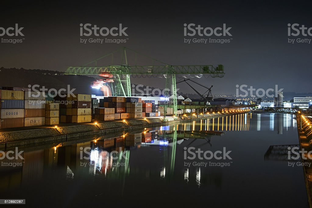 Container port and crane at night stock photo