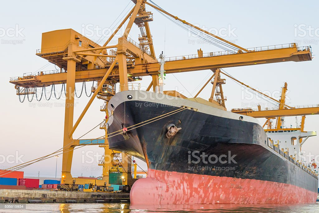 Container ship and cargo logistic the harbor in Asia , stock photo
