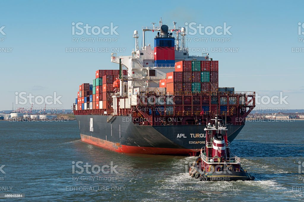 Container Ship and Tug stock photo