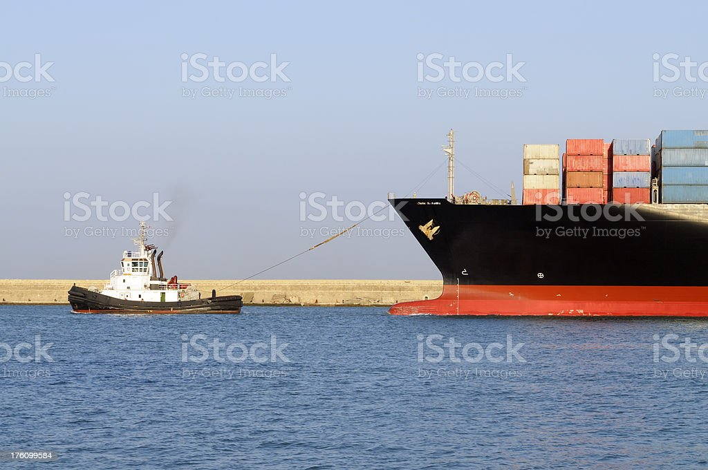 Container Ship and Tugboat stock photo