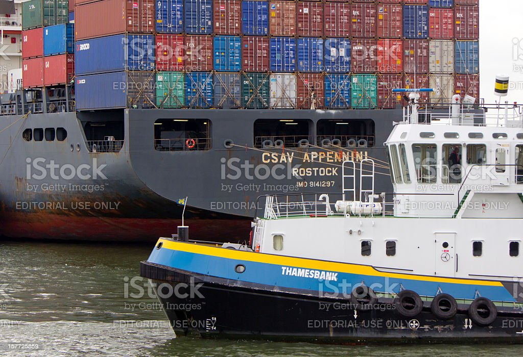 Container ship and tugboat, Rotterdam stock photo