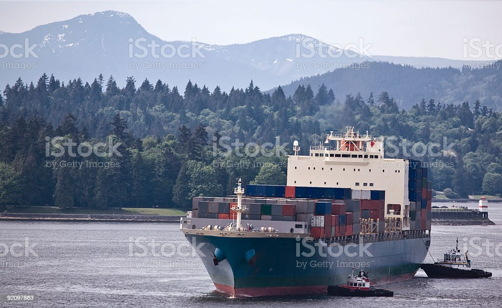 Container Ship Assisted by Tug Boats in Pacific Northwest Port royalty-free stock photo