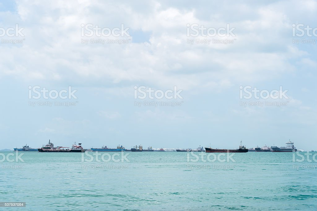 Container ship at anchor on the horizon. stock photo
