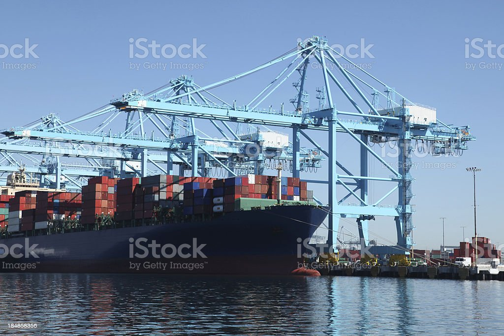 Container ship at commercial dock royalty-free stock photo
