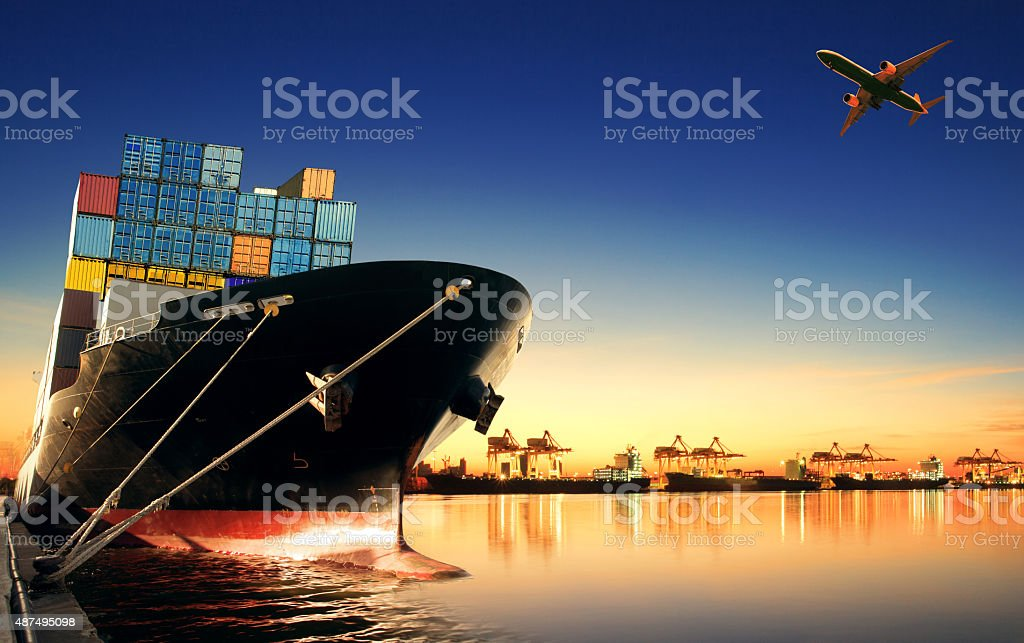 container ship at port and cargo plane stock photo