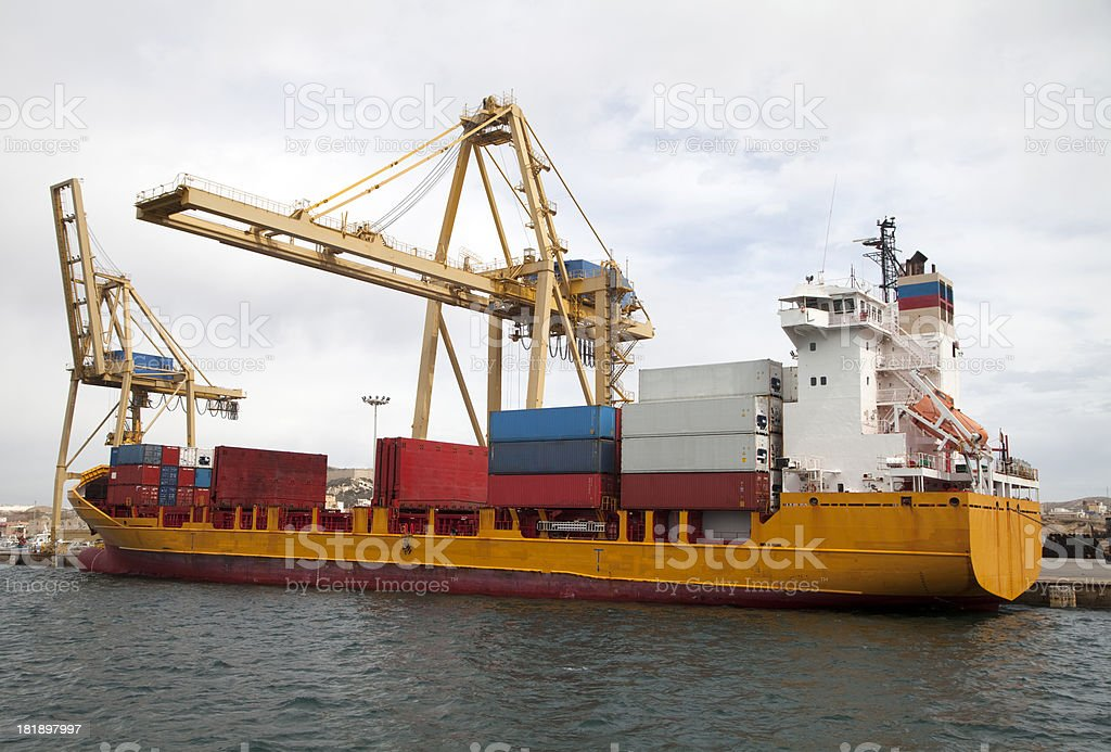 Container ship being loaded at quayside royalty-free stock photo