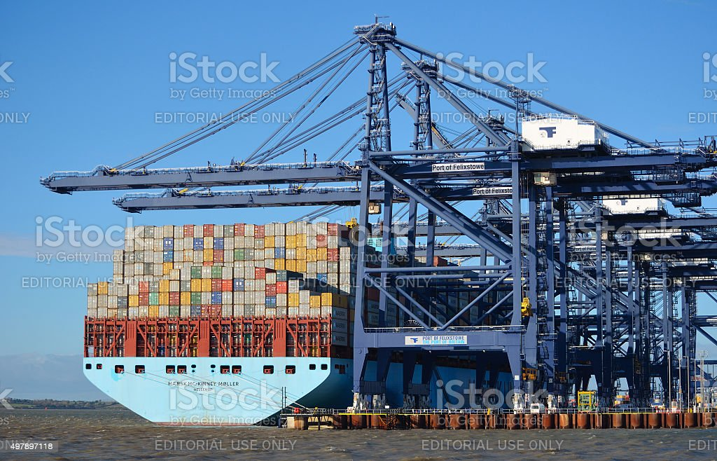 Container ship being unloaded stock photo