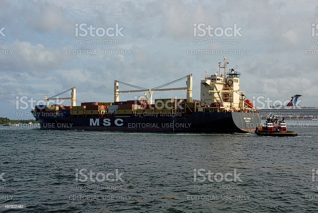 Container Ship Departs Port Everglades with Tugboat stock photo