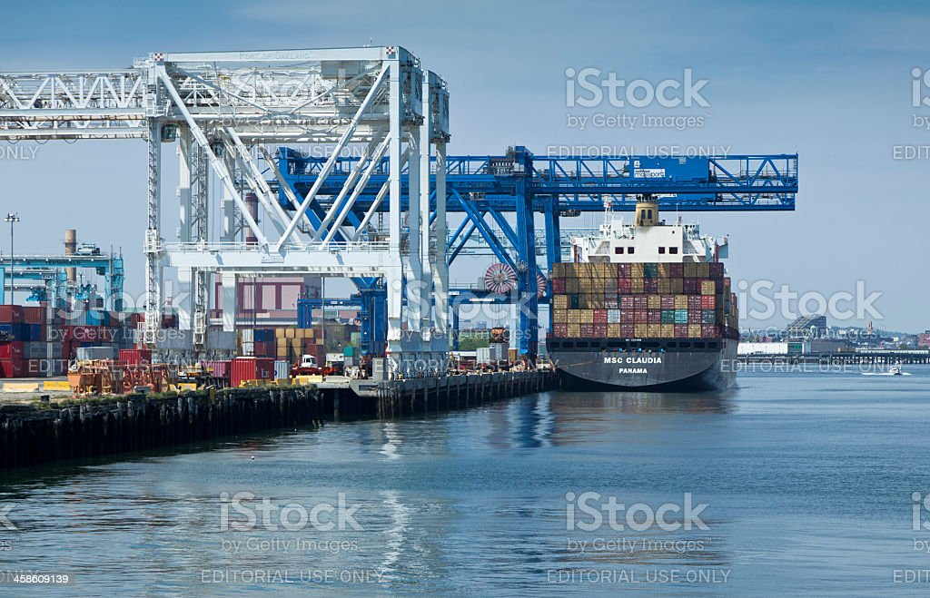 Container Ship Docked at Port of Boston Under Massive Cranes royalty-free stock photo
