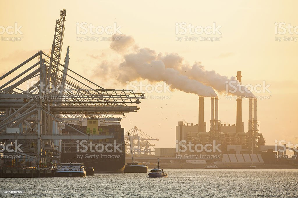 Container ship in cargo dock near Rotterdam, Netherlands. stock photo