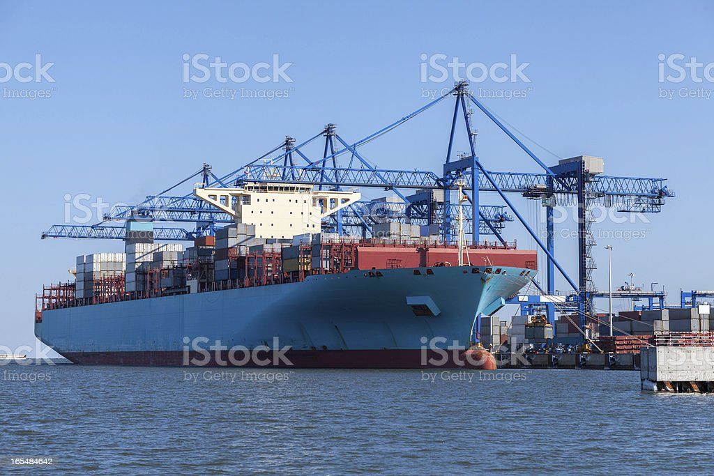Container ship in terminal royalty-free stock photo