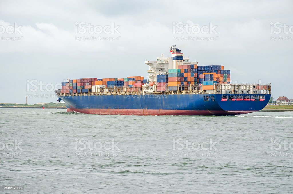 Container ship in the port of Rotterdam, Holland stock photo