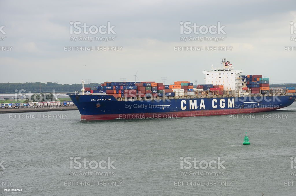 Container ship leaving from Rotterdam harbor. stock photo