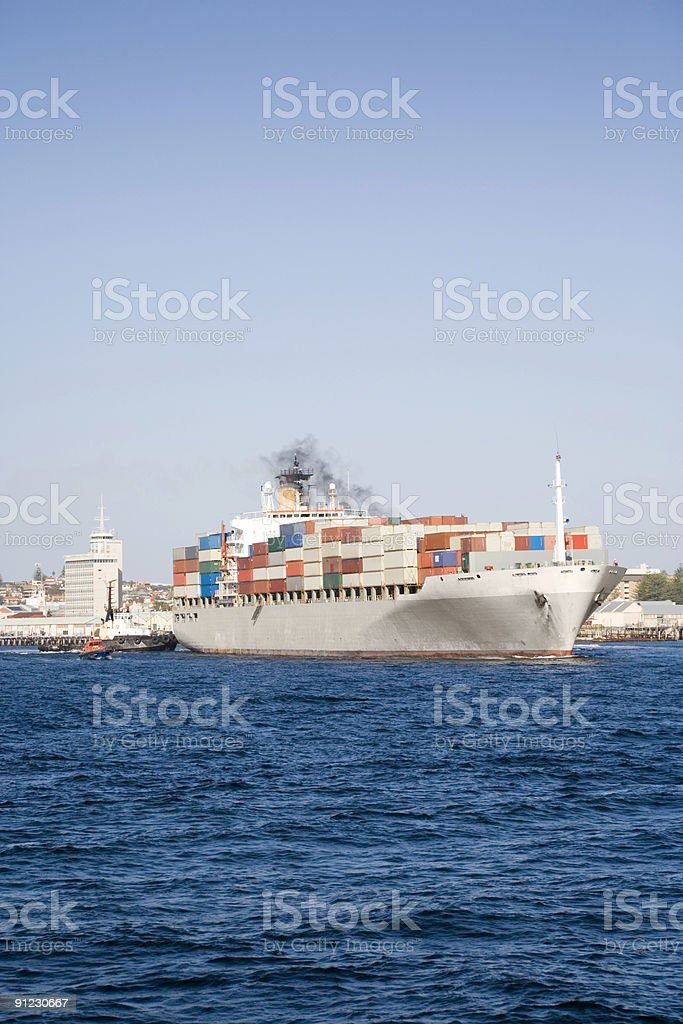 Container Ship Leaving Port With Tug and Pilot royalty-free stock photo