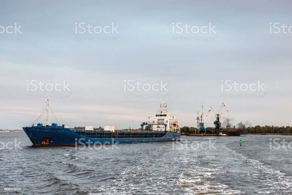 Container ship leaving the port. stock photo