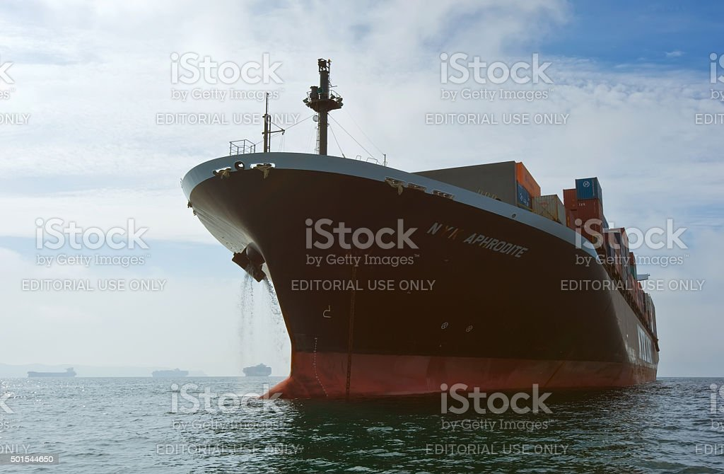 Container ship NYK Aphrodite standing on the roads at anchor. stock photo