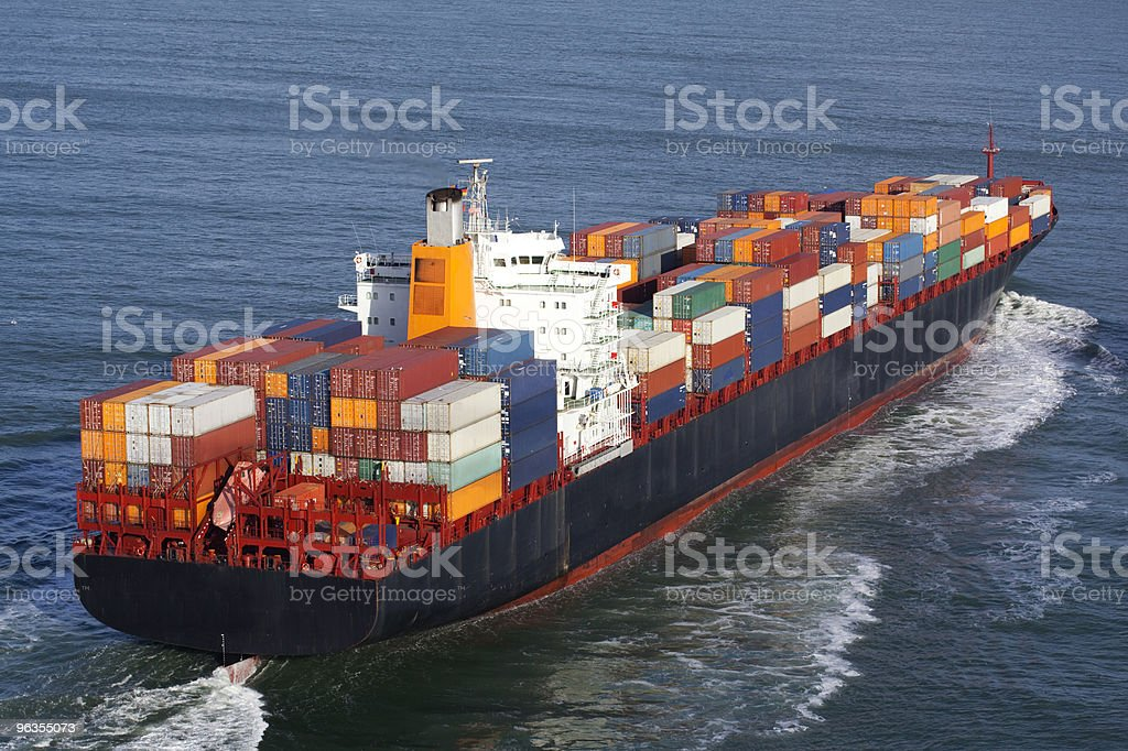 A container ship sailing across the blue ocean  royalty-free stock photo