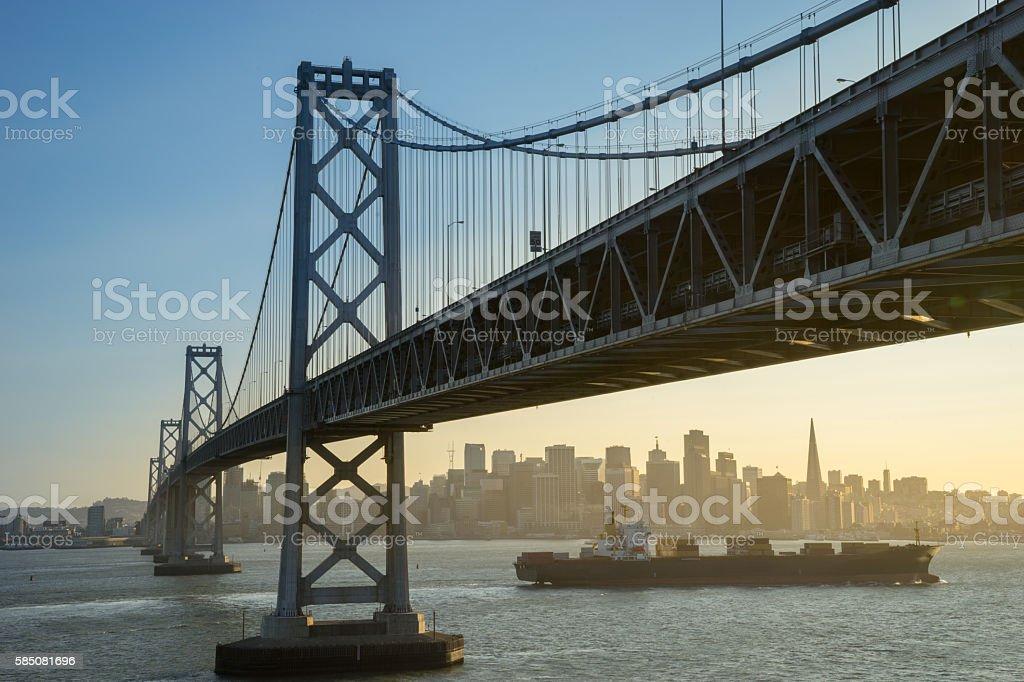 Container ship sails along San Francisco Bay at sunset royalty-free stock photo