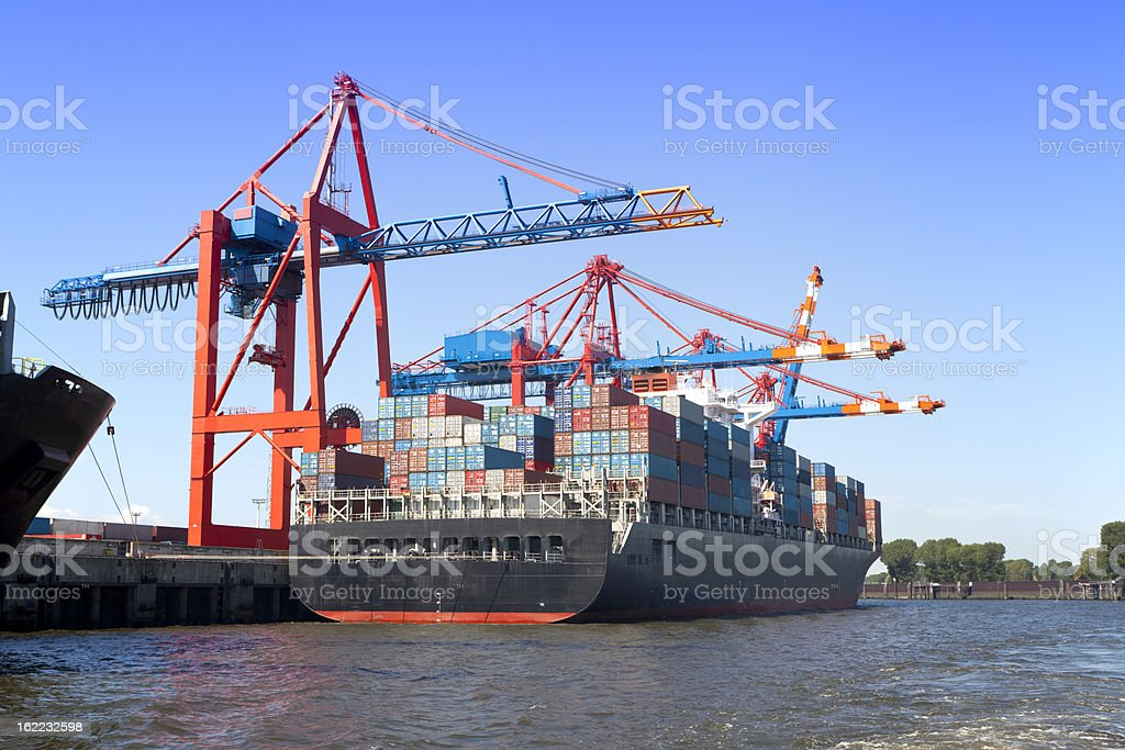 Container ship sitting on the coast stock photo