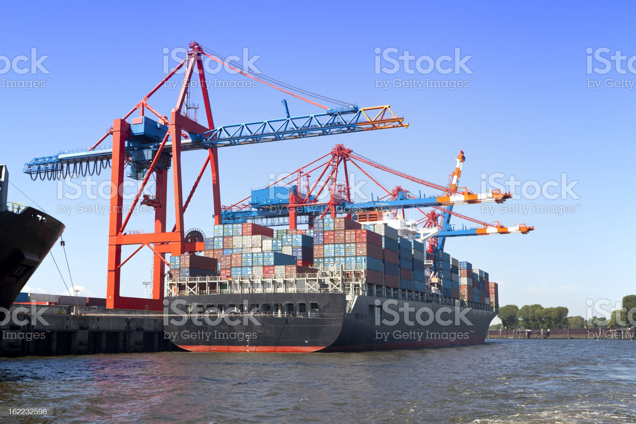 Container ship sitting on the coast royalty-free stock photo