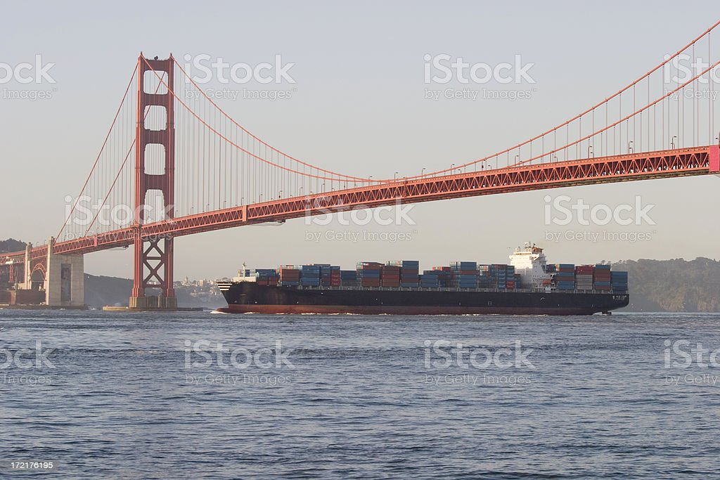 Container ship under Golden Gate Bridge royalty-free stock photo
