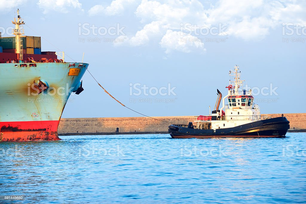 Container ship with tugboat stock photo