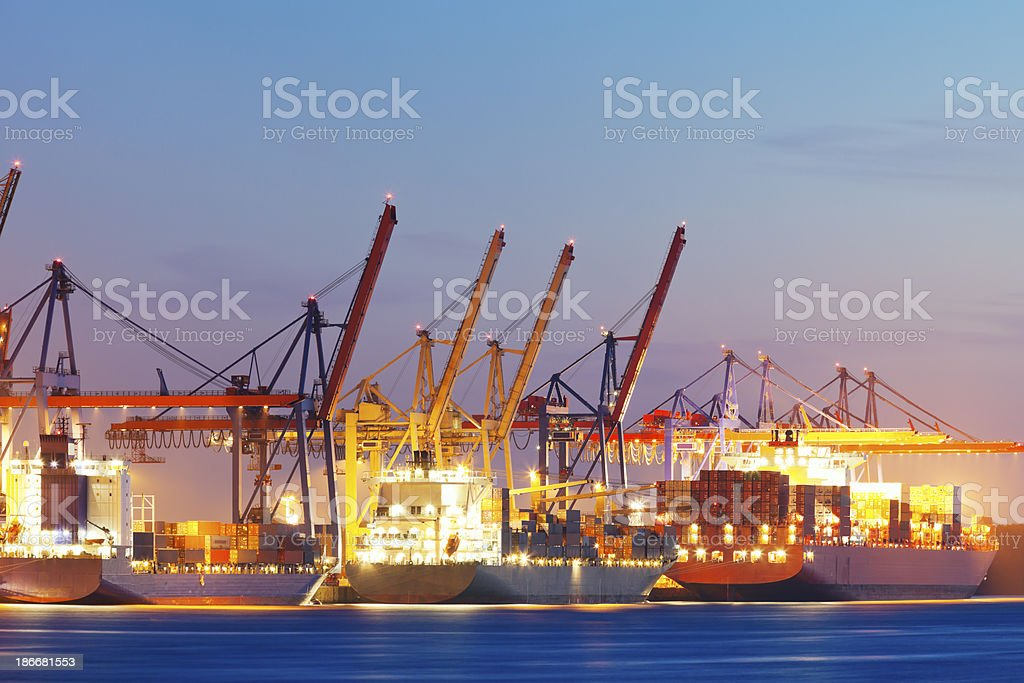 Container Ships Being Loaded at Dusk, Hamburg Harbor royalty-free stock photo
