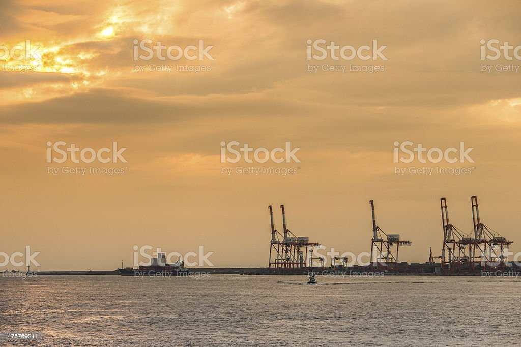 Container stacks and crane in shipyard royalty-free stock photo