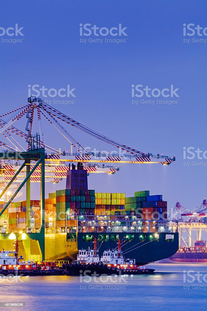 Container terminal at sunset stock photo