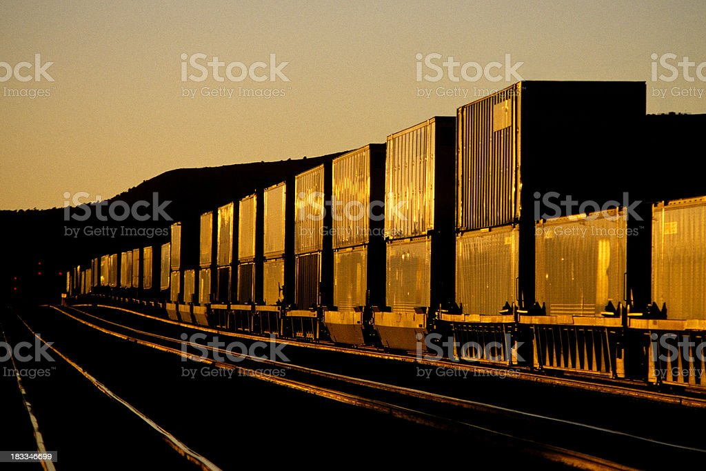 Container train at sunset stock photo
