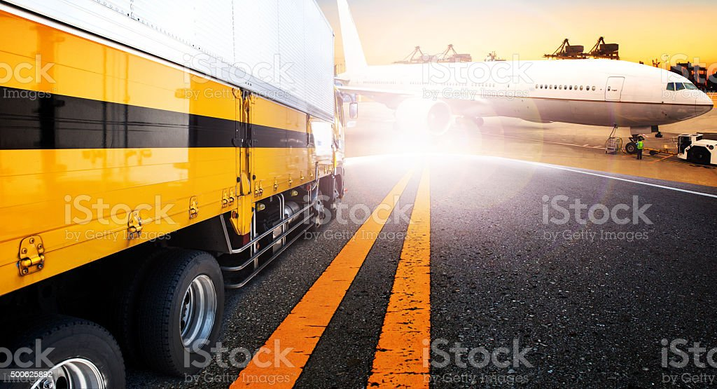 container truck and cargo plane loading stock photo