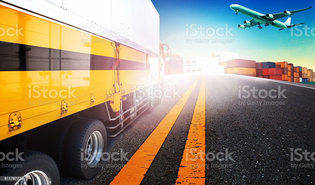 container truck and freight cargo plane flying over stock photo