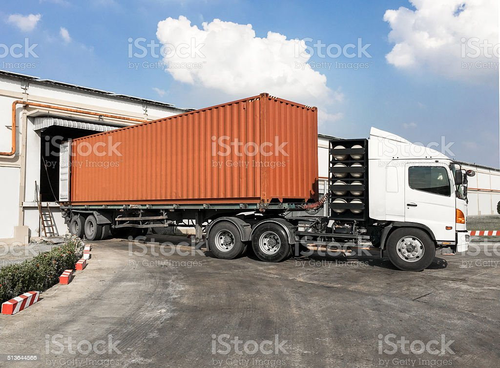 Container truck loading goods at warehouse stock photo