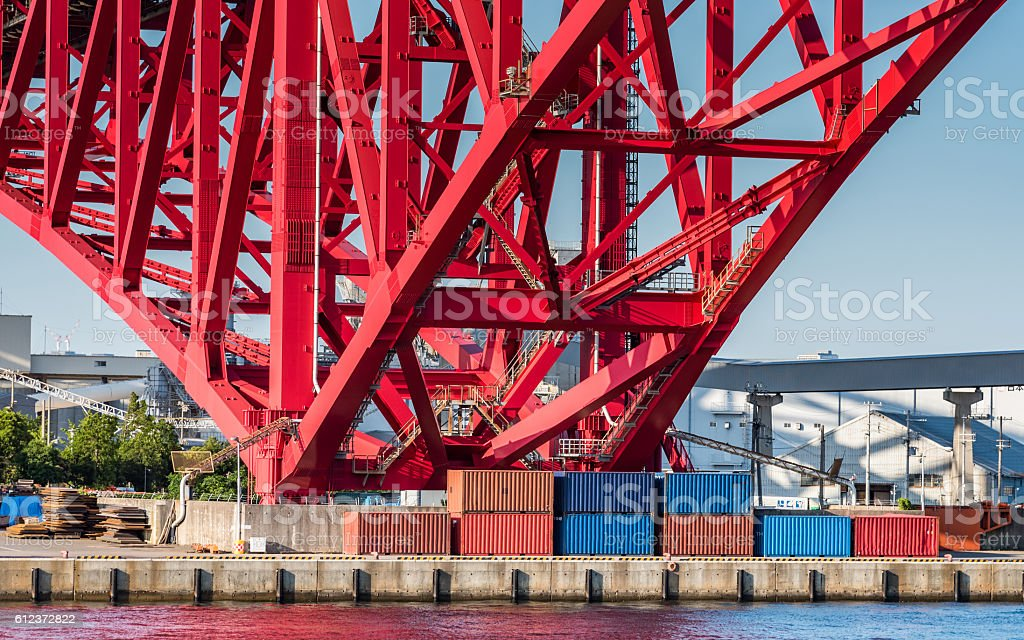 container under red bridge stock photo