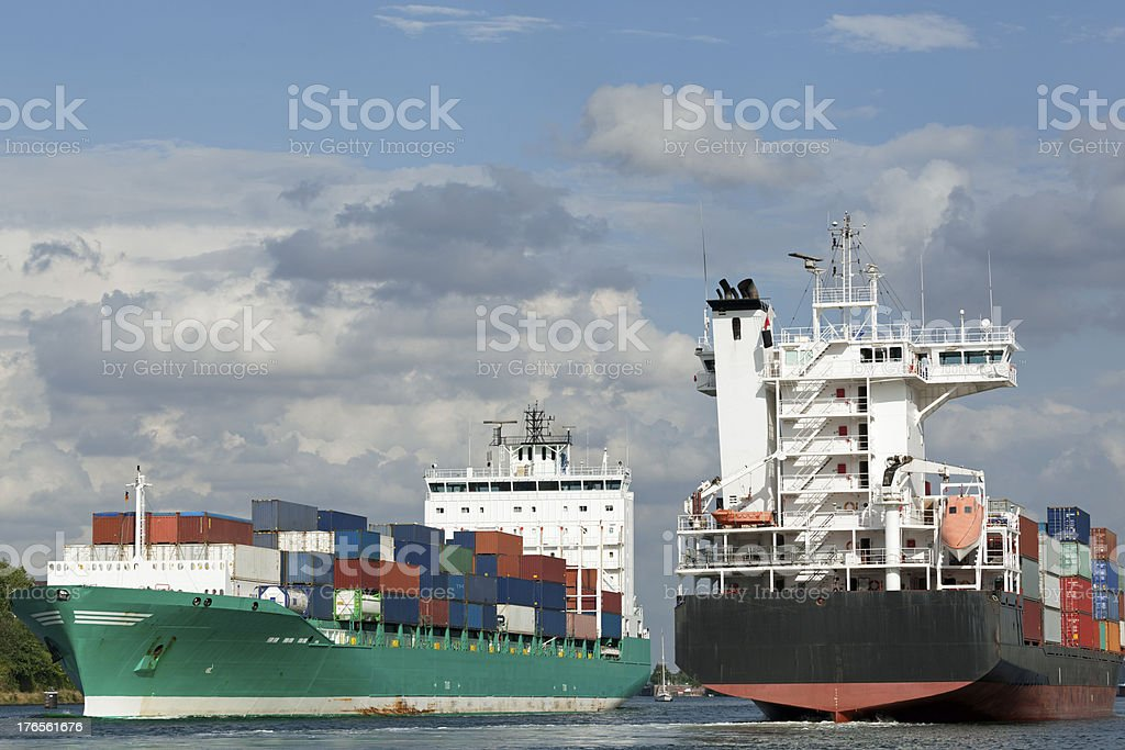 Container vessels on Kiel Canal, Germany royalty-free stock photo