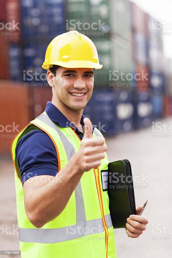 container warehouse worker giving thumb up royalty-free stock photo