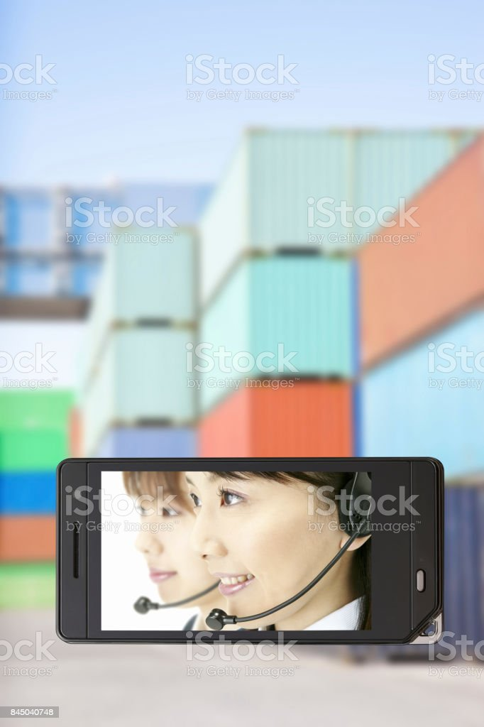 Container with the operator on the mobile screen stock photo