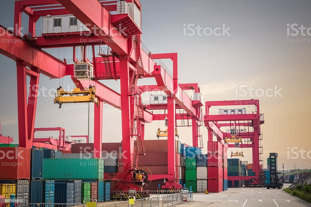 container yard at dusk stock photo