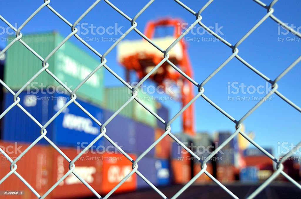 container yard security fence stock photo