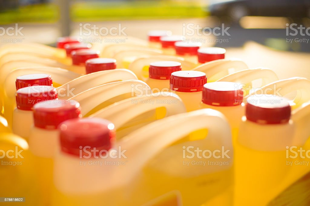 Containers, Engine oil, Gas station stock photo