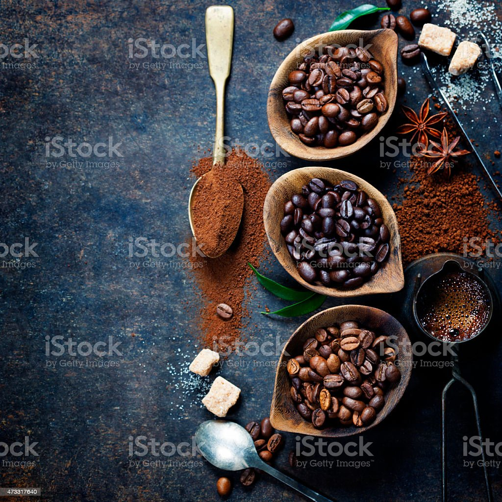 Containers of different coffee beans with spoon of powder stock photo