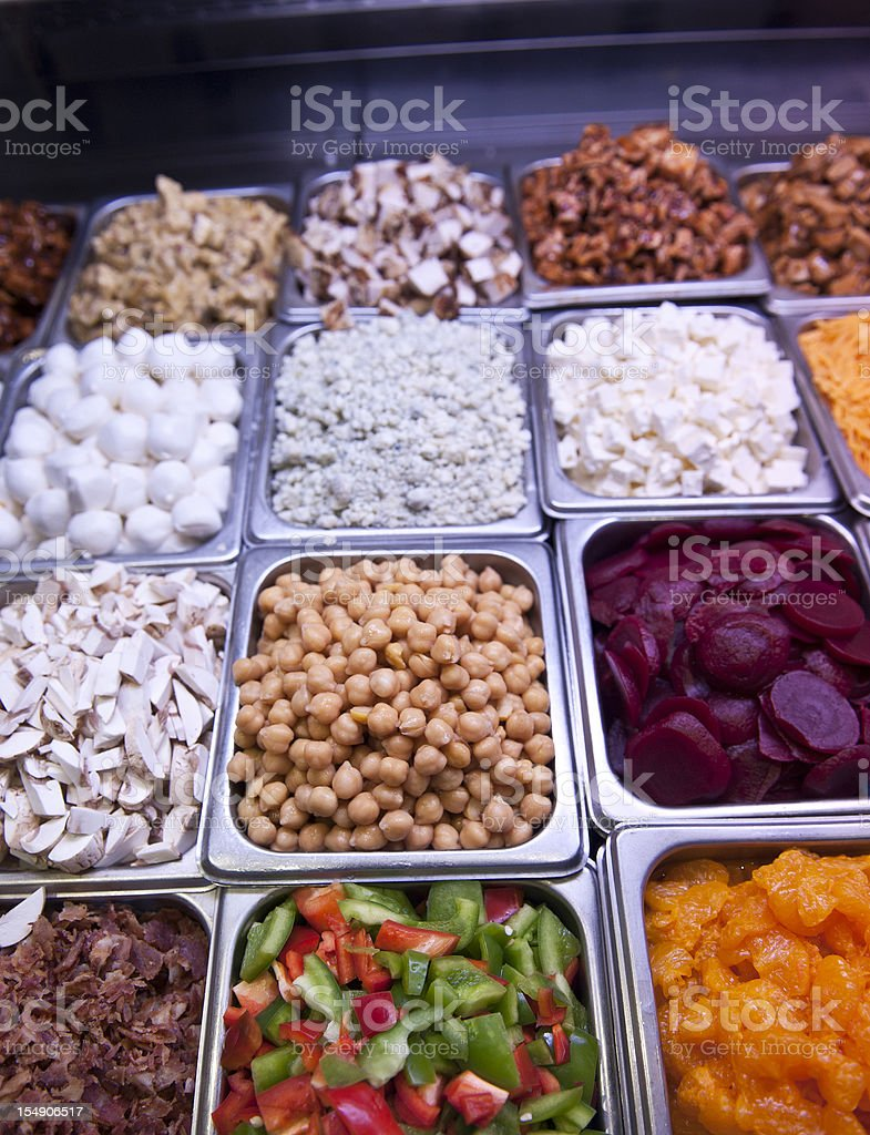 Containers of different foods on a salad bar. royalty-free stock photo