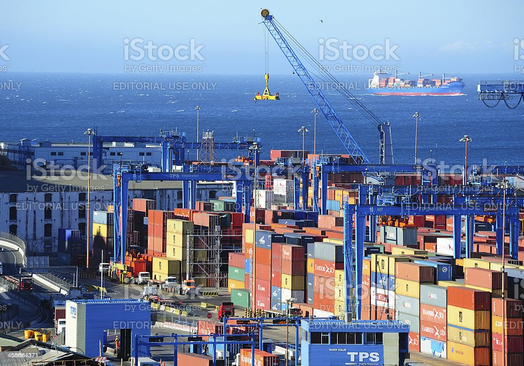 Containers ready for shipping, cargo ship in background stock photo
