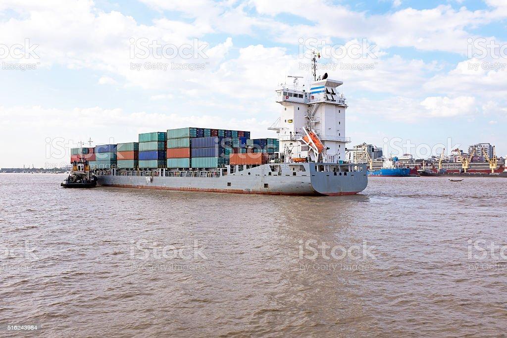 Containership on the Yangon river near Yangon in Myanmar stock photo