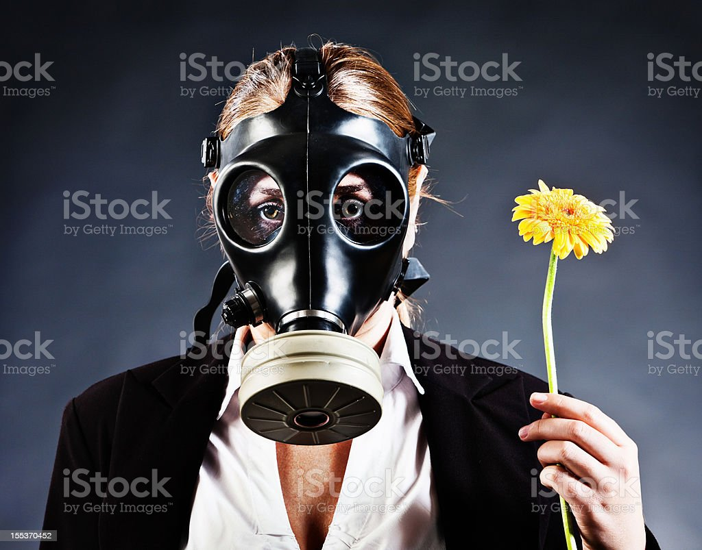Contamination, pollution or allergies force woman to wear gas mask royalty-free stock photo