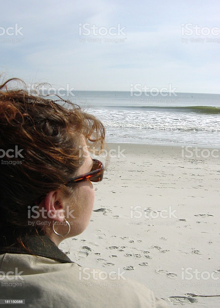 Contemplating at the Beach royalty-free stock photo