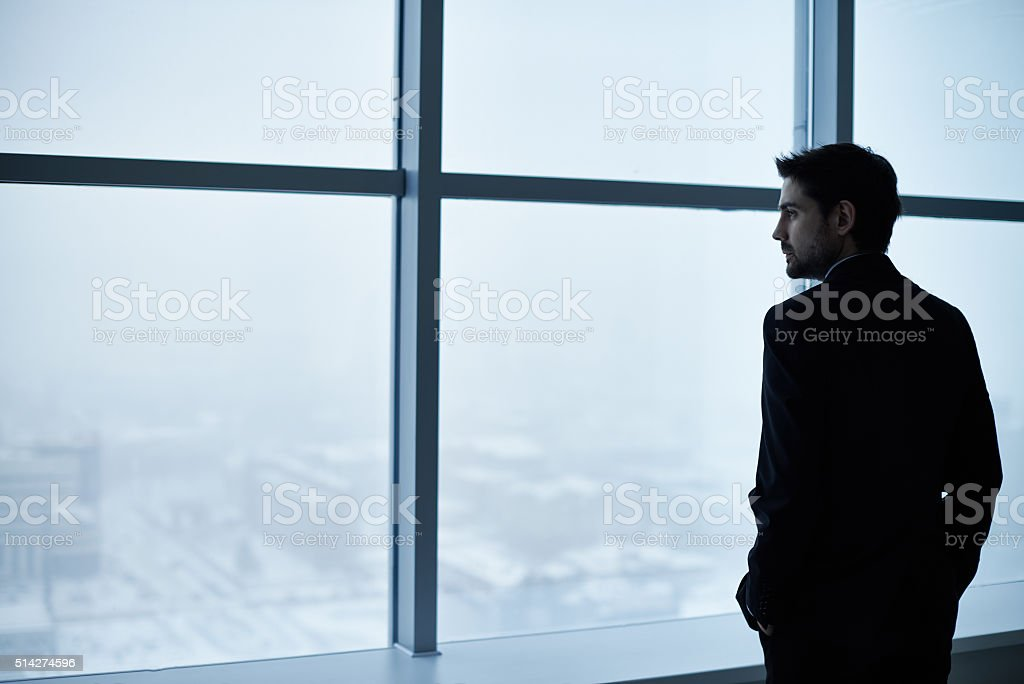 Contemplating businessman stock photo