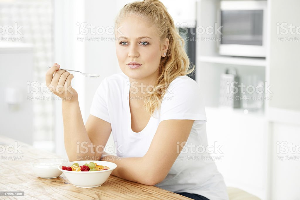 Contemplating her food choices royalty-free stock photo