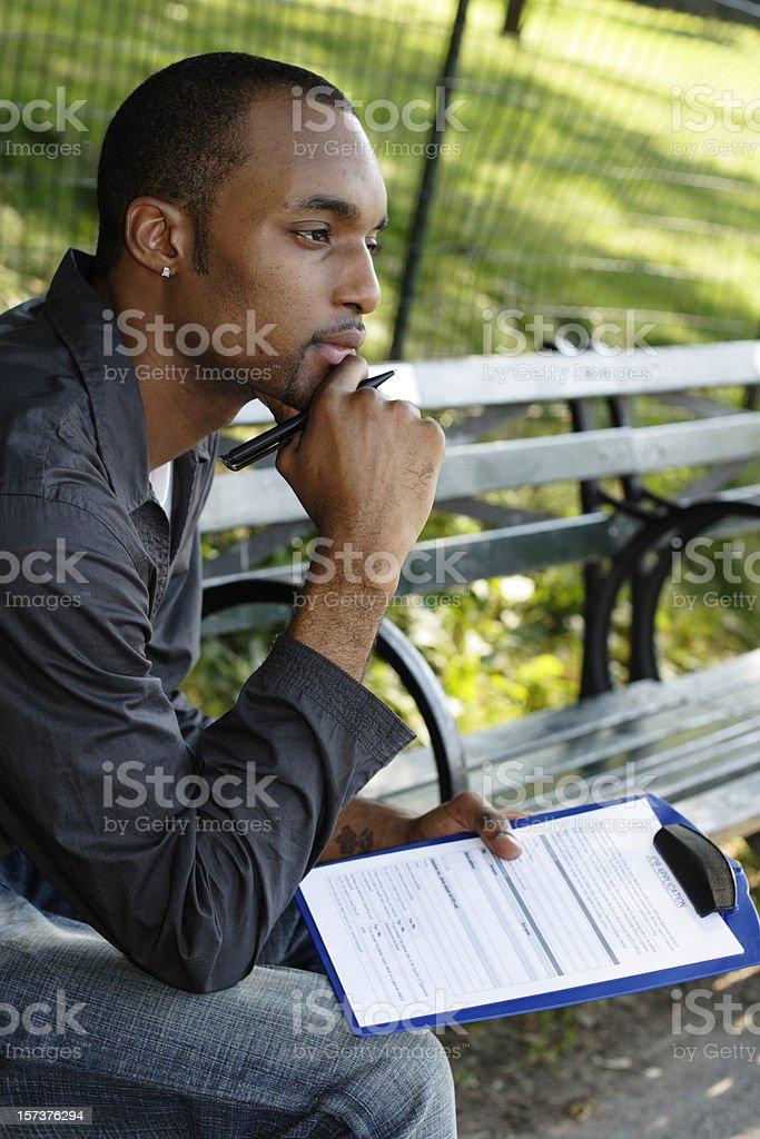 Contemplating Job Application royalty-free stock photo